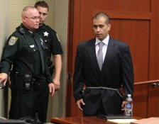 George Zimmerman (R) enters into the cou