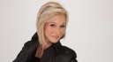 paula-white-black-outfit-posed