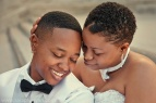 844203581-07-gay-marriage-lesbian-couple-heads-together-embrace-1024x682
